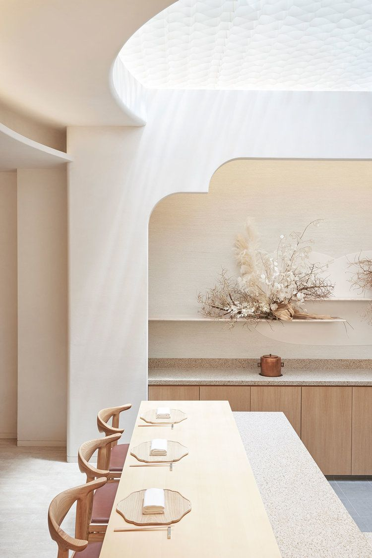 dining, white marble floor, white table, wooden stools, nook with white wall, wooden cabinet, floating shelves