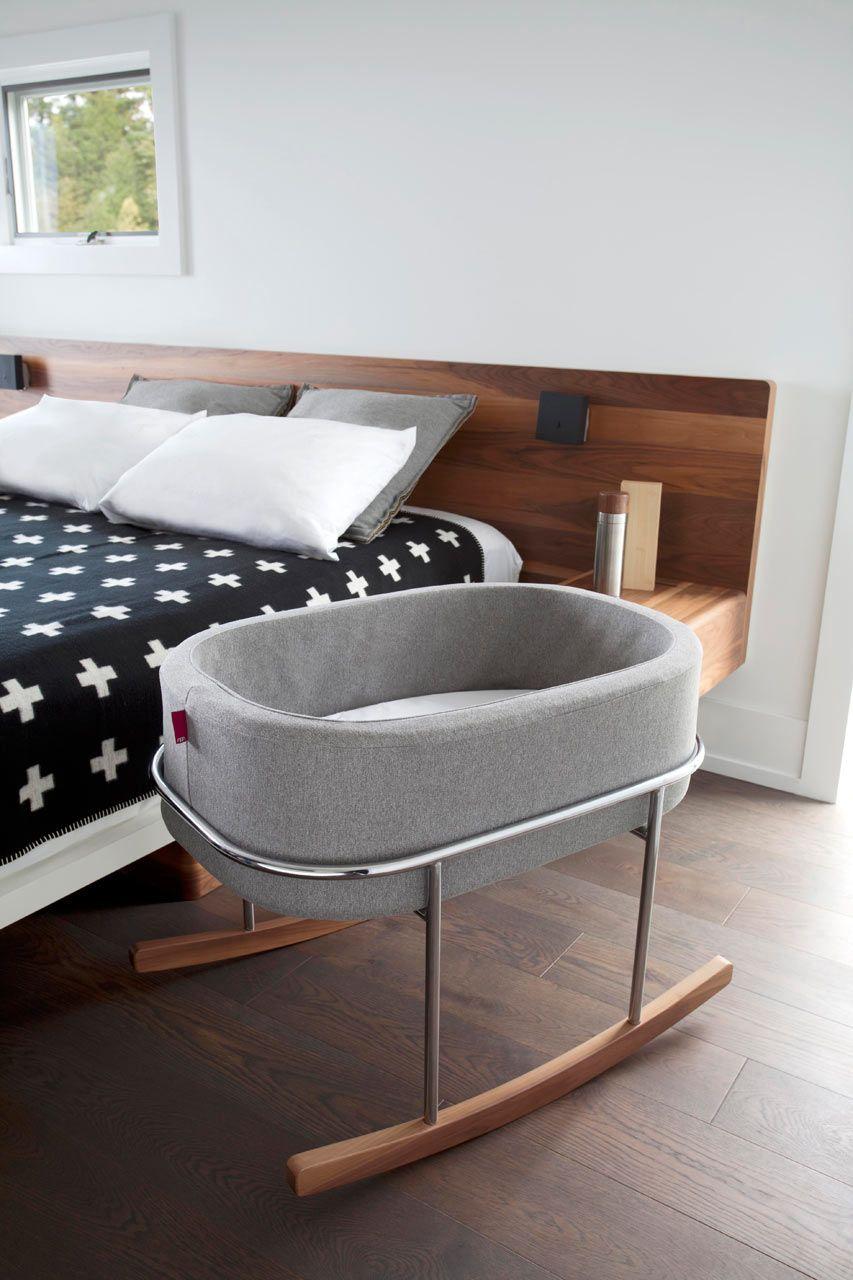grey baby rocking bed, wooden legs