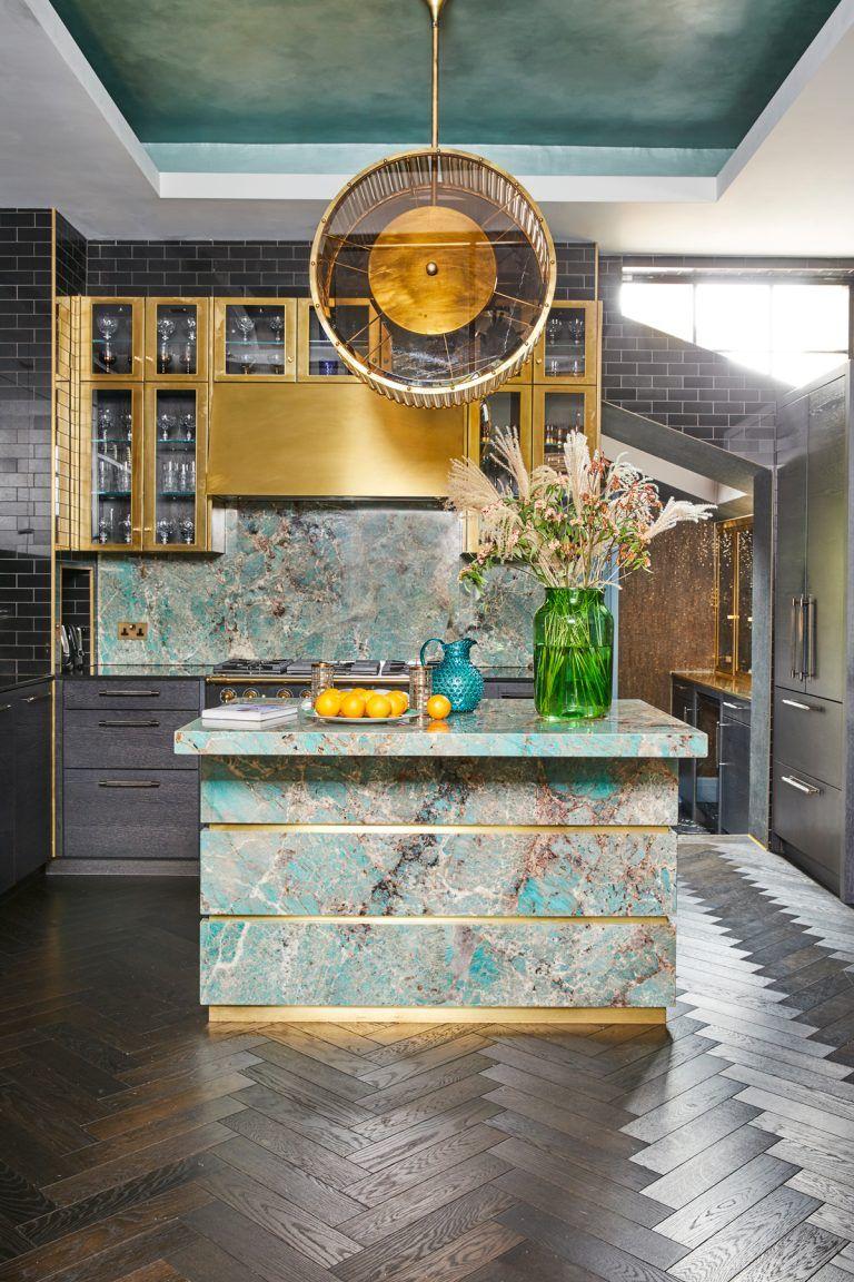 kitchen, black herringbone floor tiles, mirror wall, blue marble island, golden pendant, golden cabinet
