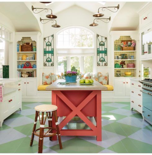 kitchen, green blue squares floor tiles, white wall, vaulted ceiling, golden sconces, window nook, built in shelves, white cabinet
