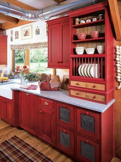kitchen, red wooden cabinet and shelves, grey marble top, wooden floor,