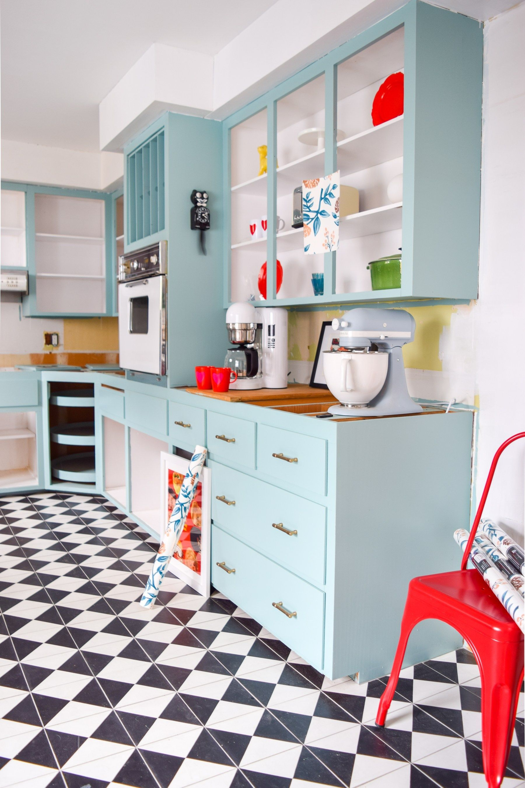 kitchen, white wall, blue cabinet, red stool