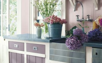 kitchen, white wooden floor, lilac wooden wall, purple wooden cabinet, blue marble top, lfoating shelves, grey apron sink