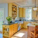 Kitchen, Wooden Floor, White Wall, Yellow Cabinet, Yellow Shelves, Wooden Island White Top, Grey Marble Top, White Pendant