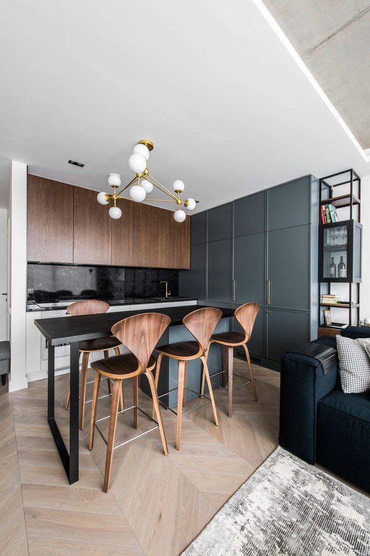 kitchen, wooden floor, wooden cabinet, green cabinet, high island, wooden stools, modern chandelier