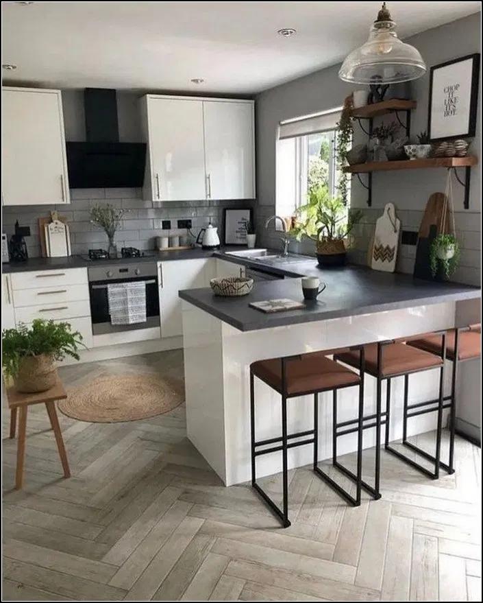 kitchen, wooden herringbone floor, grey subway tiles, white upper bottom gloss cabinet, black top, black stools