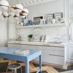 Kitchen, Wooden Zigzag Floor, White Wall, White Marble, Floating Shelves, White Cabinet With White Marble Top, Blue Table, White Modern Chandelier