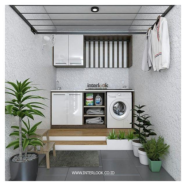 laundry room, wooden stage, white wall, wooden cabinet with white machine, white upper cabinet