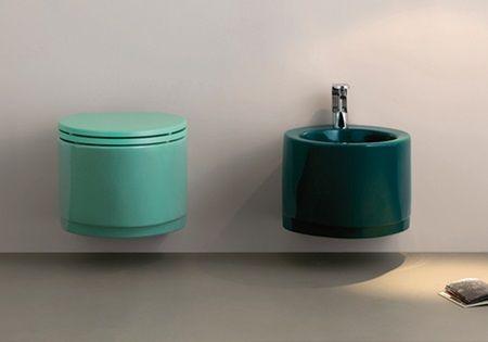 light green toilet, dark green round sink, silver faucet