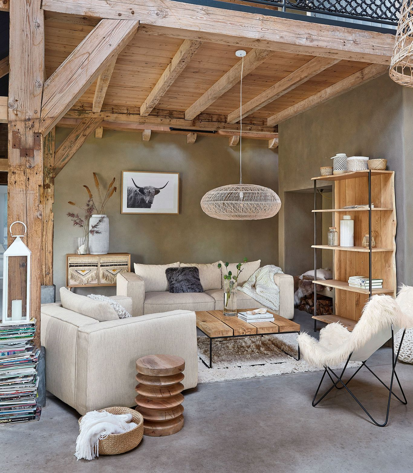living room, grey floor, brown wall, white sofas, wooden coffee table, white rattan pendant, white chair, wooden ceiling