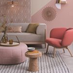 Living Room, Grey Rug, Pink Accent Wall, Pink Round Ottoman, Red Chair, Grey Sofa, Pendant