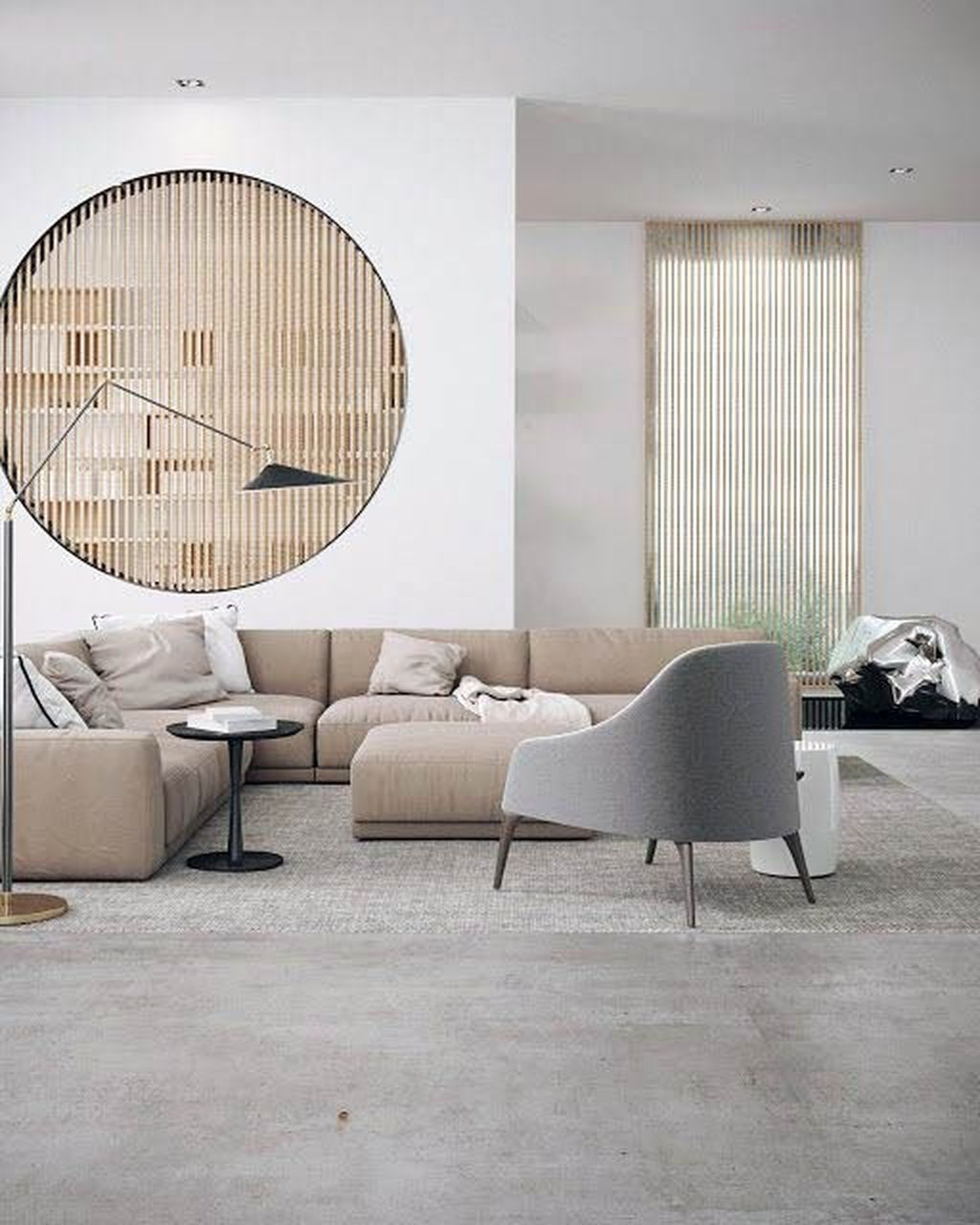living room, grey rug, white wall, wooden grid, brown corner sofa, white chair, black round side table