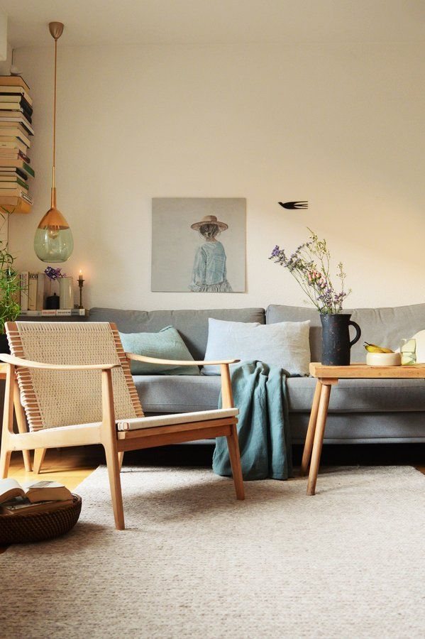living room, white rug, wooden floor, grey sofa, wooden chair, wooden coffee table, pendant