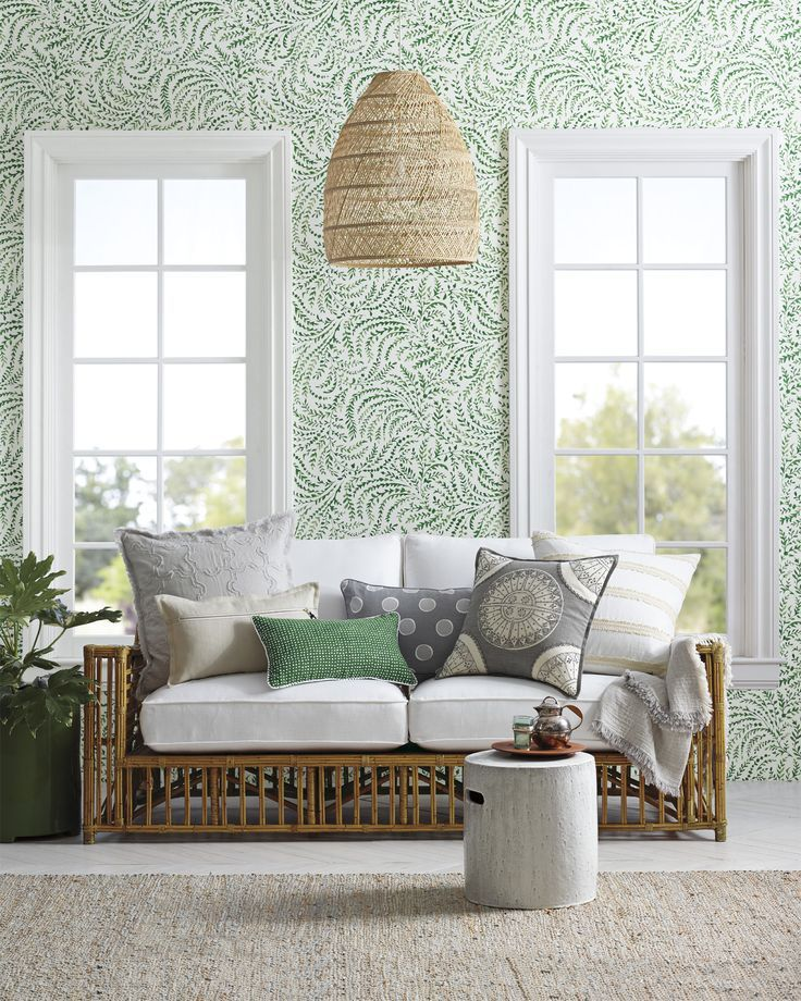 living room, white wooden floor, white framed window, rattan sofa with white cushion,, rattan pendant