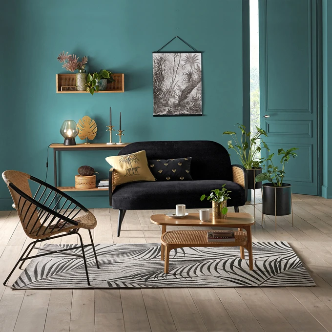 living room, wooden floor, green wall, green chair, wooden coffee table, black velvet sofa, rattan chair