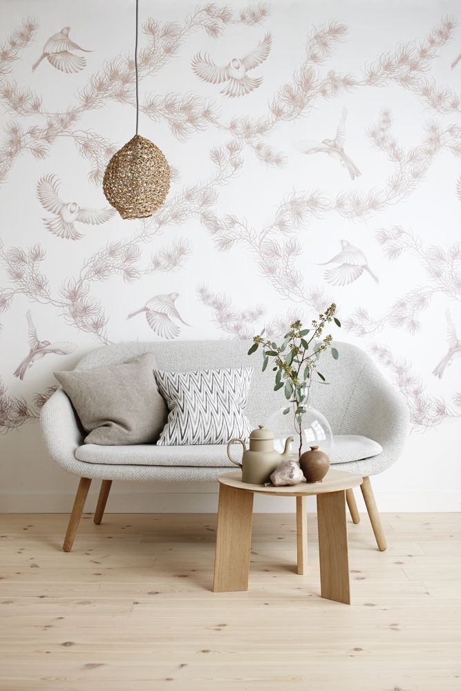 living room, wooden floor, patterned wall, rattan pendant, grey sofa, wooden coffee table