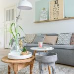 Living Room, Wooden Floor, White Patterned Rug, Wooden Round Coffee Table, Blue Round Tray Table, Grey Sofa, White Floor Lamp