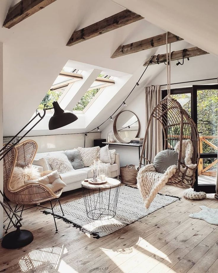 living room, wooden floor, white vaulted ceiling, white sofa, rattan chair, rattan swing, white rug, round coffee table