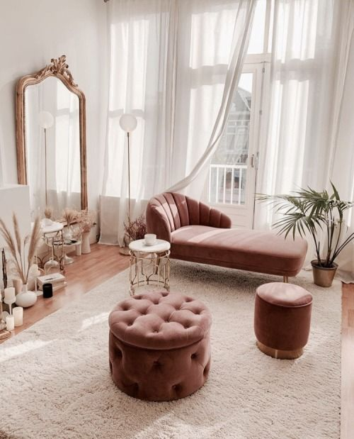 living room, wooden floor, white wall, pink lounge chair, pink tufted ottoman, pink ottoman, white rug, mirror