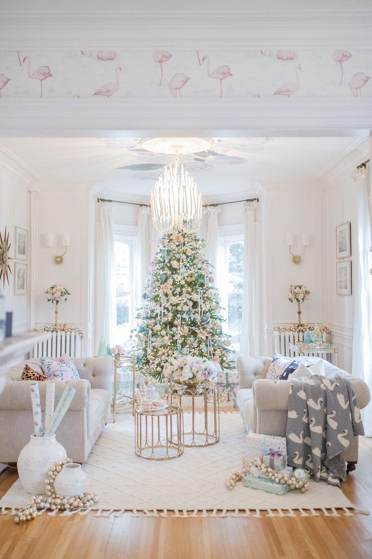 living room, wooden floor, white wall, window bay, chandelier, white sofas, golden framed coffee tables, white sconces