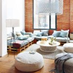 Living Room, Woodenf Floor, White Wall, Brick Wall, Wooden Crate, Blue Cushion, White Round Coffee Table, White Round Ottoman