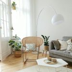 Living Room, Woodenf Floor, White Wall, White Floor Lamp, Rattan Rocking Chair, Grey Sofa, Geometrical Coffee Table, White Rug