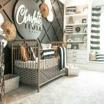 Nursery, Gey Rug, Black Accent Wall, Iron Crib, Round Name Plat, White Shelves, White Window Nook
