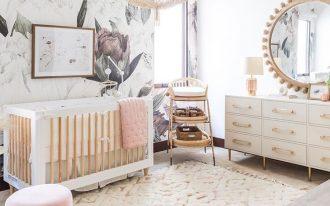 nursery, white rug, wooden floor, white wall, patterned wall, white wooden crib, white cabinet, round mirror, fringe pendant