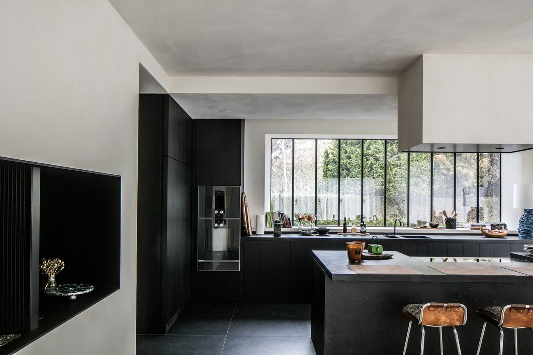 open kitchen, black cabinet, tall glass windows, black bottom cabinet, black white island