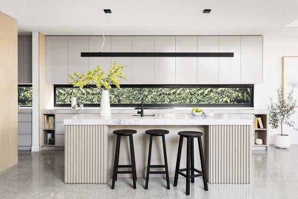 open kitchen, white upper cabinet, bottom cabinet, white marble island, glass backsplash with black frame, black stools