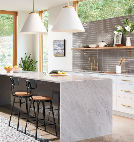 open ktichen, white wall, white bottom cabinet, grey marble island, white pendants, black stools, grey subway backsplash, glass window