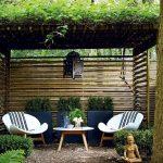 Patio, Stones, White Modern Table, White Modern Chairs, Black Maroco Pendant, Blue Plants Pots, Rattan Ceiling, Plants Above