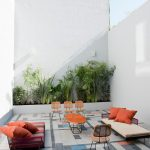 Patio, White Wall, Grey Floor Tiles, Low Benches,