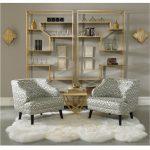 Patterned Chairs, Golden Side Table, Grey Wall, Golden Framed Shelves