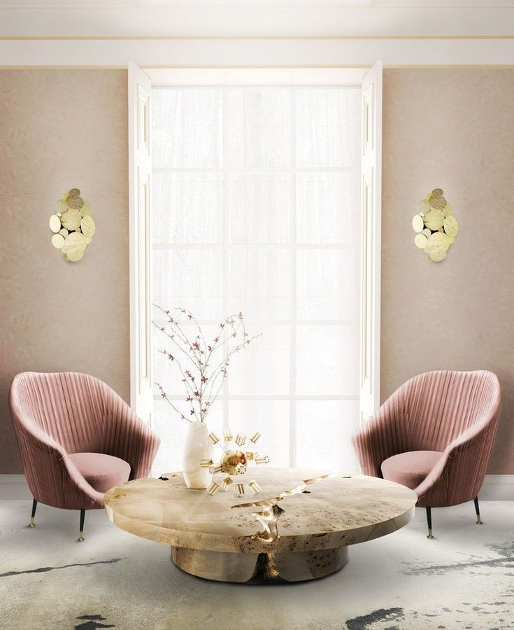 pink velvet chairs, wooden round coffee table, white floor, pink wall, sconces