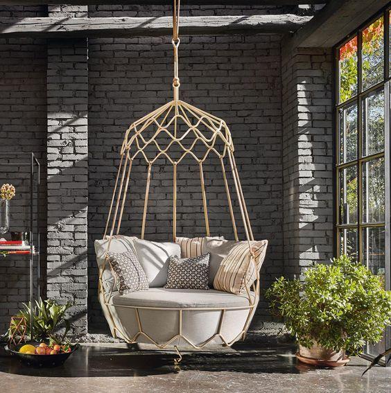 rattan love swing with grey cushion