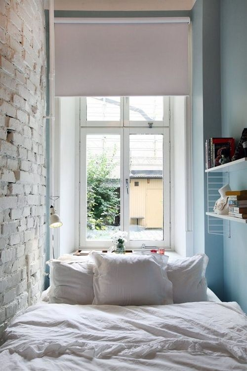 small bedroom, blue wall, white exposed wall, white framed window, window nook for study table