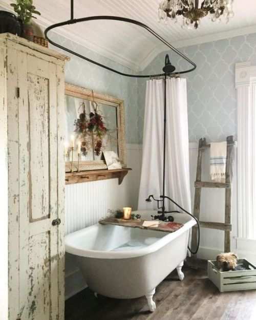 vintage bathroom, wooden floor, light wallpaper, white wainscoting, white tub clawfoot, black round curtain rod