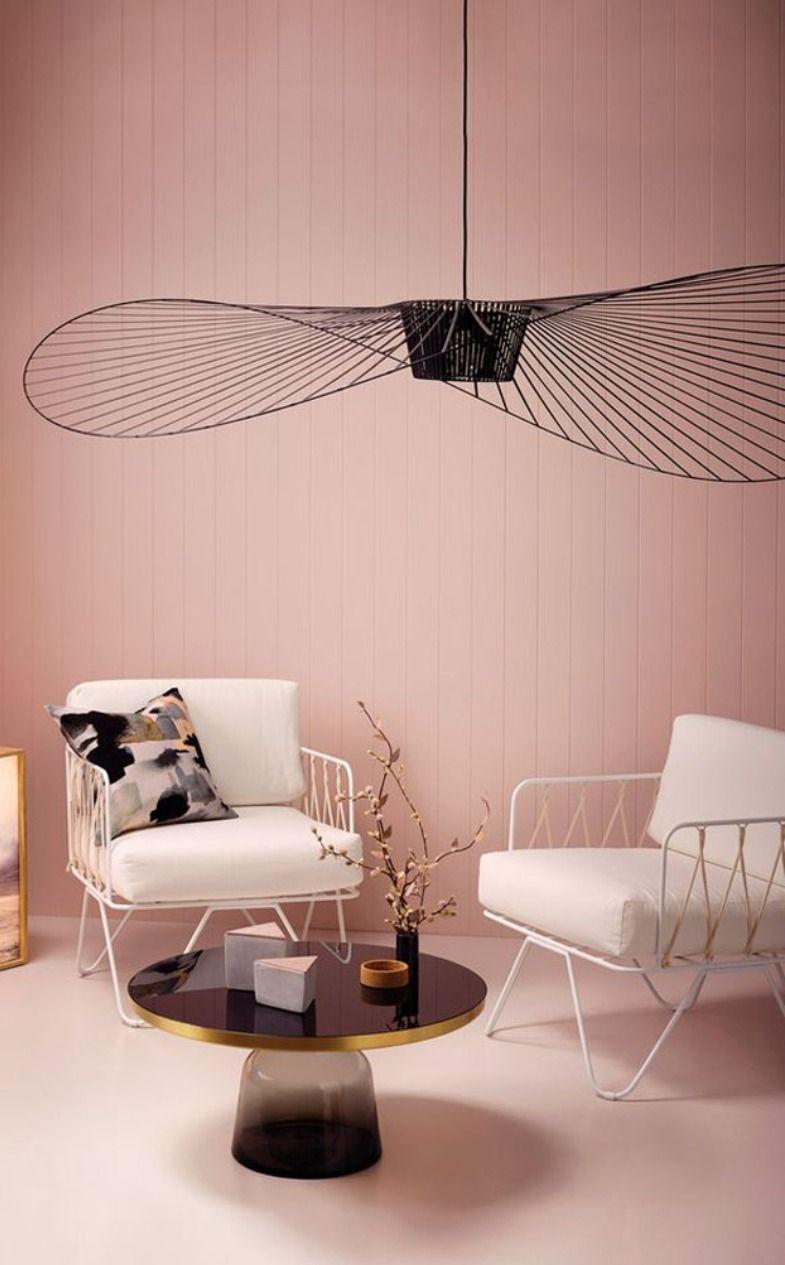 white framed chair, white cushion, black large pendant, black round coffee table, pink shiplash, pink seamless floor