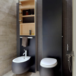 White Grey Floating Toilet, Matching Sink, Black Accent Wall, Black Accent Shelves