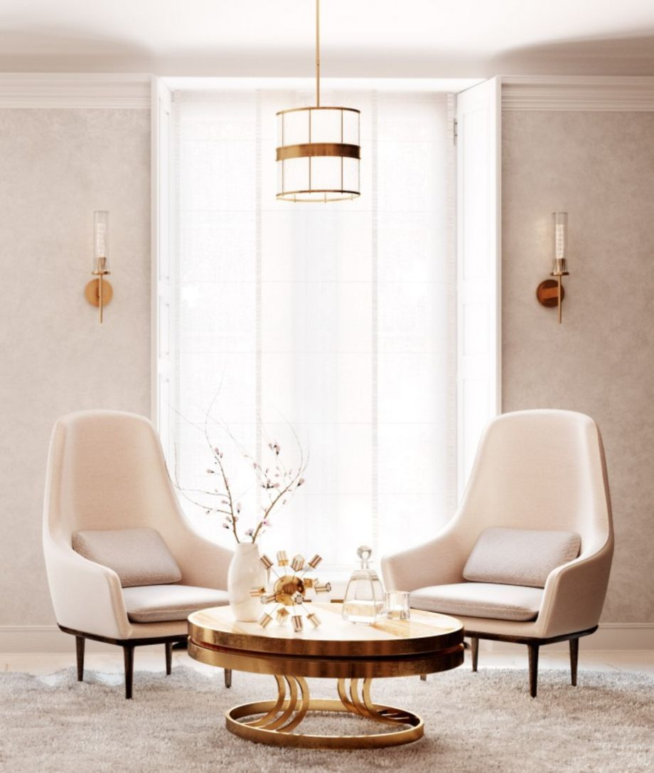 white velvet chair with tall back, golden round coffee table, cream wall, white pendant