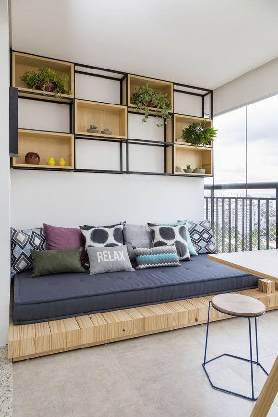 wooden bench, blue cushion, shoe shelves.jpge cushion, floating wooden shelves, patio