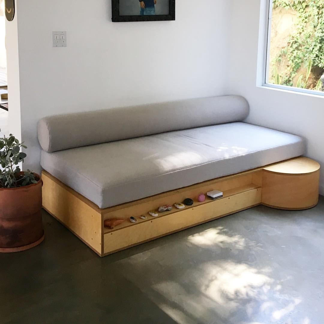 wooden bench, grey cushion, round space, seamless floor