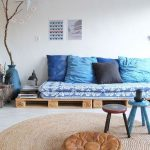 Wooden Crate, Blue Cushion, Blue Pillows, Grey Seamless Floor, Round Rattan Rug, Brown Leather Ottoman