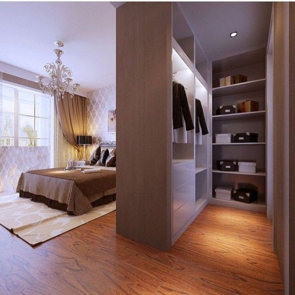 wooden white wardrobe, wooden table, bed, chandelier