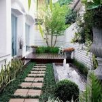 Yard, Grass, Brown Steps, Wooden Stage, Plants, Whtie Wooden Grid, Pond